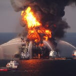 FILE - In this April 21, 2010 file photo provided by the U.S. Coast Guard, fire boat response crews spray water on the burning BP Deepwater Horizon offshore oil rig. An April 20, 2010 explosion at the platform killed 11 men, and the subsequent leak released an estimated 172 million gallons of petroleum into the gulf. (U.S. Coast Guard via AP, File)