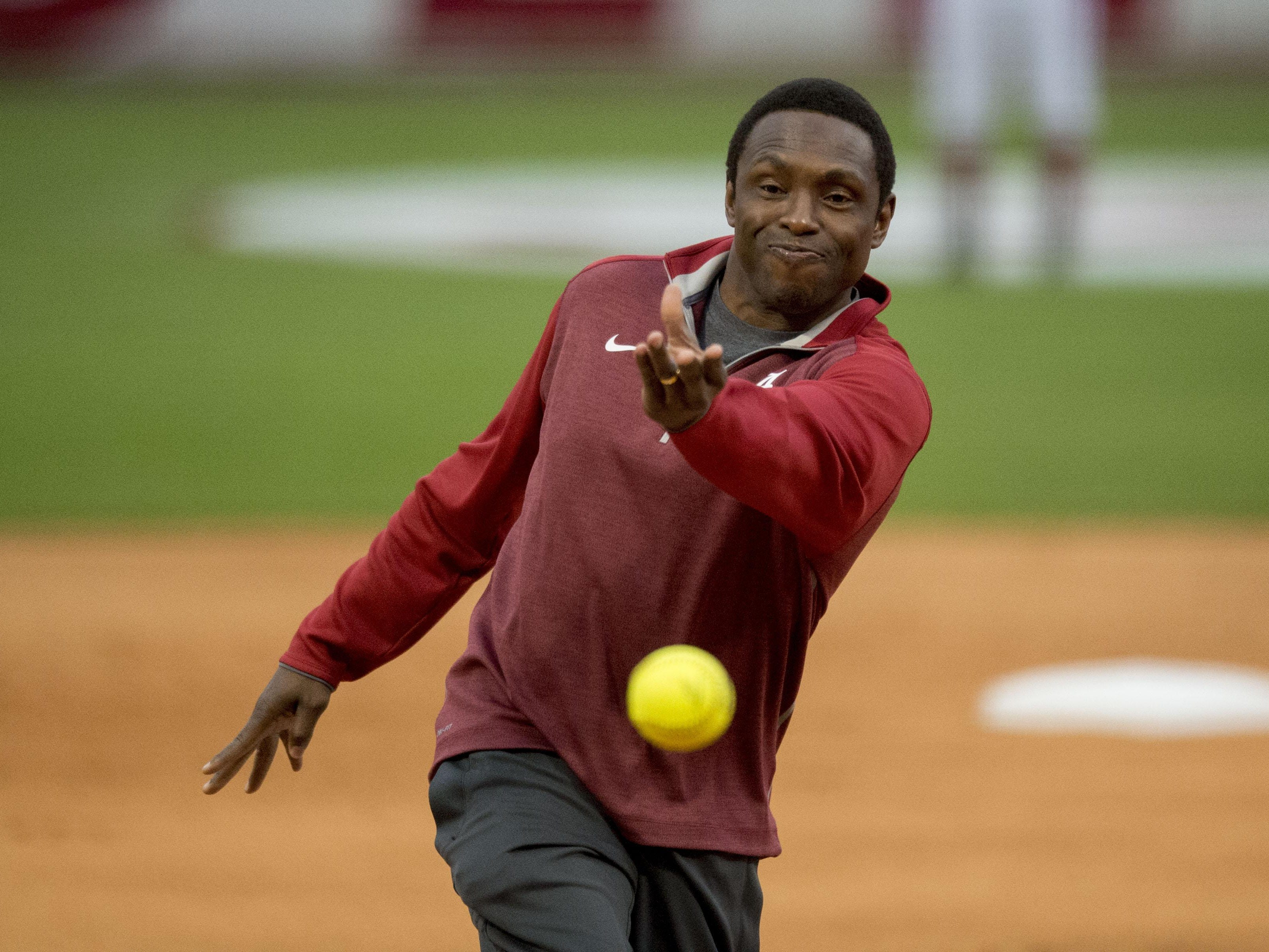 Alabama basketball coach Avery Johnson throws out the first pitch before an Alabama softball game against Tennessee in Tuscaloosa. The new coaching quartet of Johnson, Ben Howland, Mike White and Rick Barnes will join the rest of the SEC in looking to knock off John Calipari and his Kentucky Wildcats.