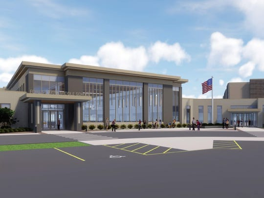 The front of the new Forest Park Middle School, designed by Punkett-Raysich Architects, will feature a secure entrance and large windows that look into the cafeteria space.