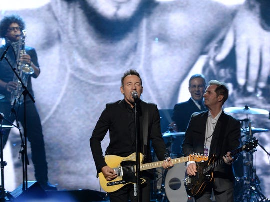 Bruce Springsteen and  the E Street Band perform onstage at the 29th Annual Rock And Roll Hall Of Fame Induction Ceremony at Barclays Center of Brooklyn on April 10, 2014 in New York City.