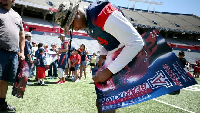Arizona quarterback Khalil Tate signs autographs for fans at the UA's Fan Appreciation Day.