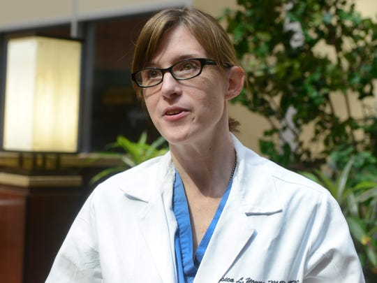 Dr. Jessica Young, who runs the Obstetrics Drug Dependency Clinic at Vanderbilt, talks about the cycle of addiction and how treacherous it is to treat these women and how complicated their lives are, in the atrium of Vanderbilt Medical Center on May 22, 2014.