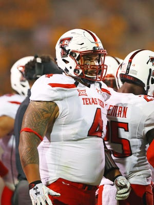 Texas Tech Red Raiders defensive lineman Breiden Fehoko (4) against the Arizona State Sun Devils at Sun Devil Stadium.