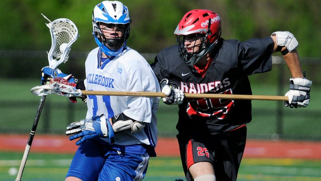 Millbrook High School's Rory Shoemaker gets pressured by Red Hook's Teddy Ross on Tuesday in Millbrook.