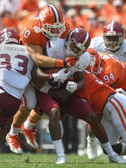 Clemson linebackers Ben Boulware (10), top, and Jalen Williams (30) bring down Troy wide receiver Deondre Douglas (80) during the 3rd quarter Saturday, September 10, 2016 at Clemson's Memorial Stadium.