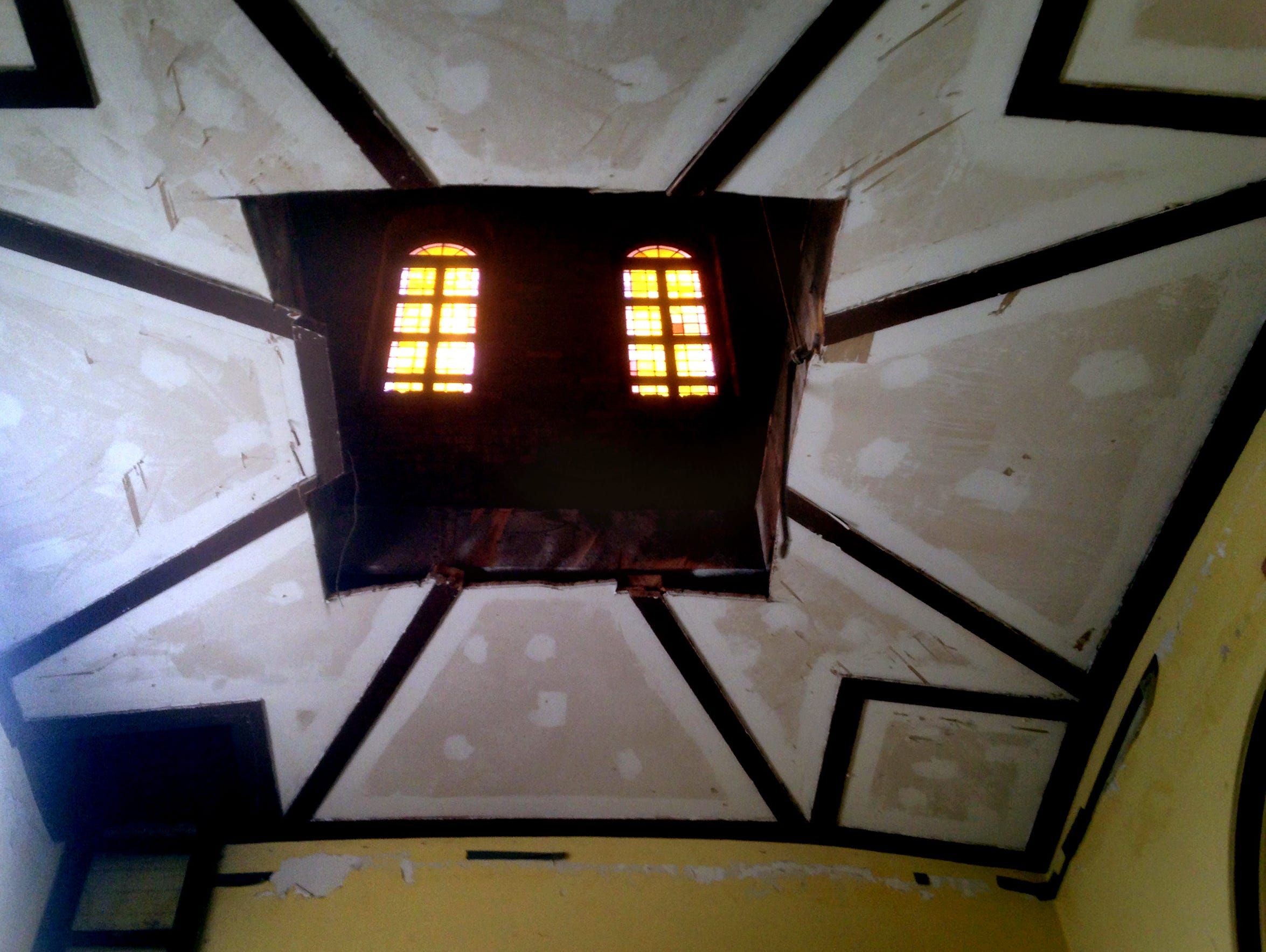 The hole in the ceiling leads into the bell tower of