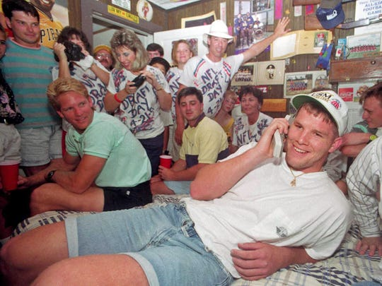 Brett Favre takes a call from the Falcons on his draft day. (Associated Press)