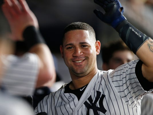 New York Yankees' Gary Sanchez is congratulated by teammates after hitting a home run against the New York Mets during the eighth inning of a baseball game, Monday, Aug. 14, 2017, at Yankee Stadium in New York. The Yankees defeated the Mets 4-2. (AP Photo/Rich Schultz)