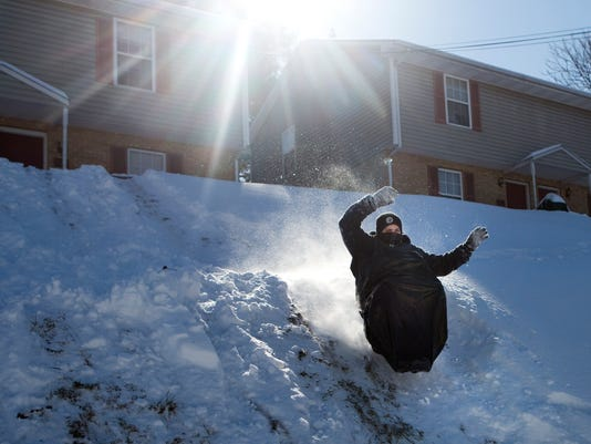 Southwest Virginia residents emerge to enjoy sunny, snow-covered day