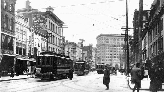 A string of street cars about to be replaced by buses, about 1931.