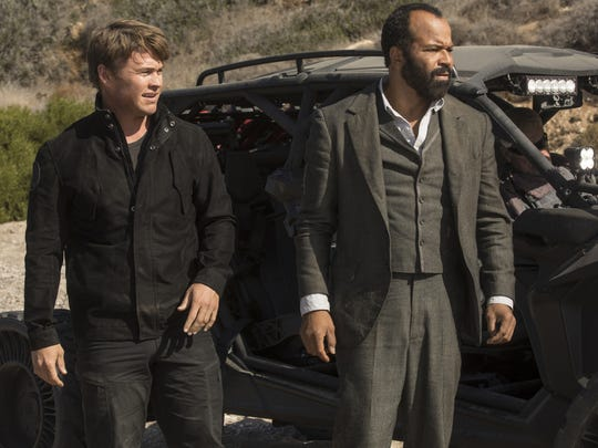 The presumed dead Ashley Stubbs (Luke Hemsworth, left)