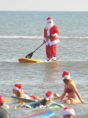 The Surfing Santas of 2017, had puny waves Dec. 24,
