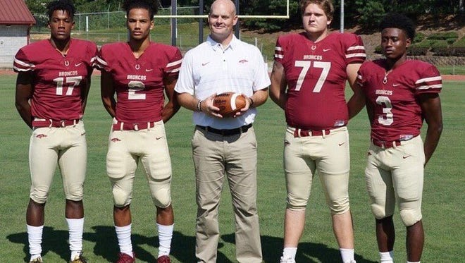 Four-star wide receiver Matthew Hill (2), shown second from the left in this picture of Brookwood High School's team captains, verbally committed to Auburn's 2018 recruiting class on Aug. 17, 2017.