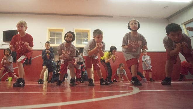 Kids get loose during a recent Vineland Mini Wrestling practice. The organization is under new leadership and making big strides.