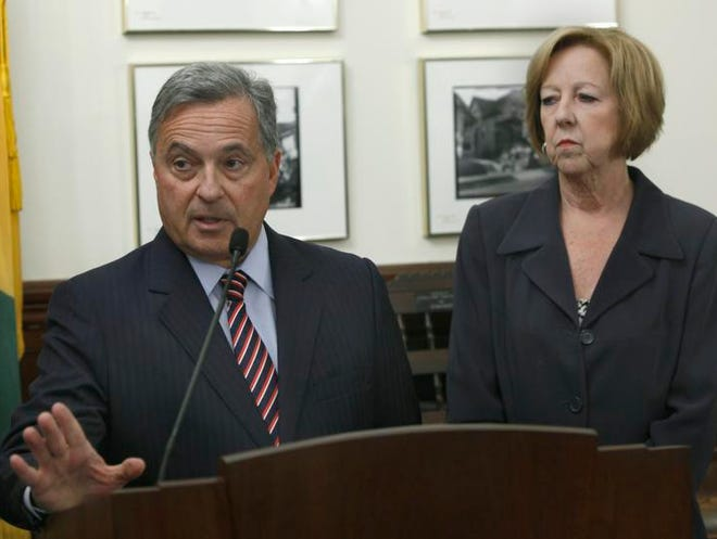 Former Attorney General Dennis Vacco, left, and Maggie Brooks during a news conference Wednesday at the Monroe County Office Building on Main Street.