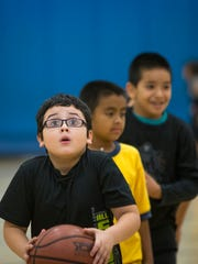 Youths participate in activities in the gym at the Hartley and Ruth Barker Branch of Boys & Girls Clubs of Greater Scottsdale.