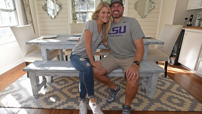 Dan and Mary Catherine Kreamer enjoy the farmhouse style table that Dan made for their new home.