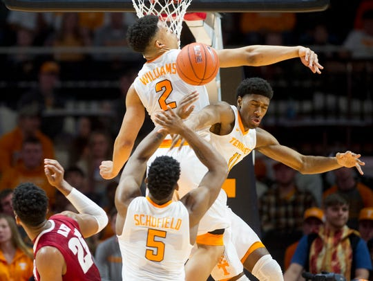 Tennessee's Grant Williams (2), Kyle Alexander and