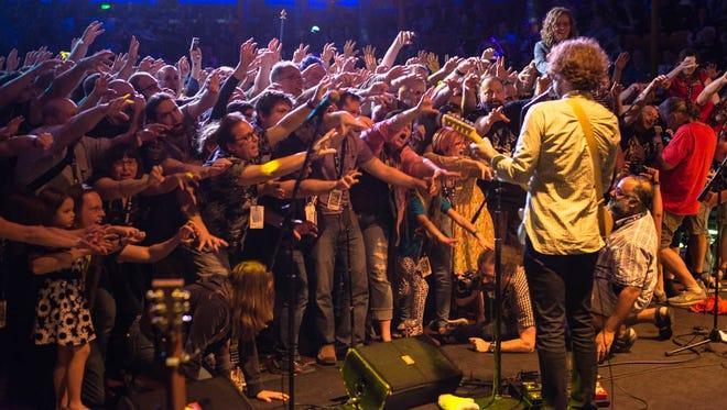 Jonathan Coulton leads a zombie crowd sing-along aboard JoCo Cruise.
