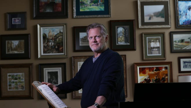 Operatic tenor Gregory Kunde in his Penfield home, decorated with art he and his wife have collected as he has performed around the world.