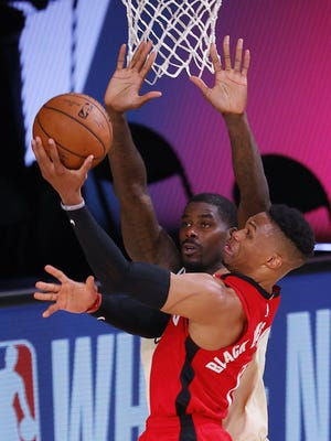 The Rockets' Russell Westbrook puts up a shot over the Bucks' Eric Bledsoe on Sunday,.