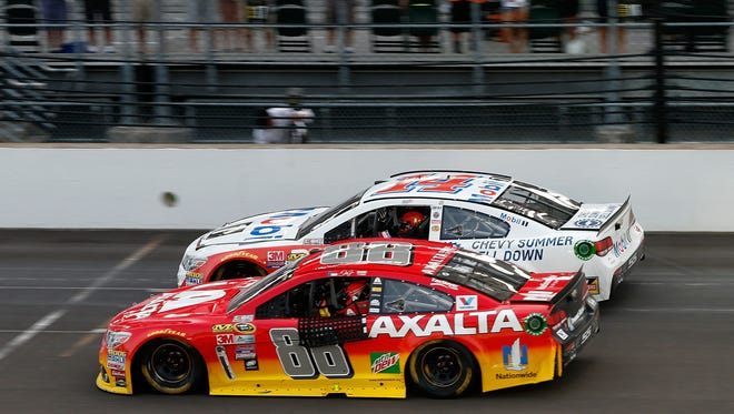 Tony Stewart (14) and Jeff Gordon (88) take a celebratory lap around Indianapolis Motor Speedway at the conclusion of Sunday's Brickyard 400. The drivers have a combined seven wins at Indianapolis.