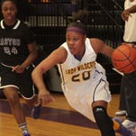 Curtessia Dean charges the basket against Warren Easton. Dean scored a team-high 15 points in the 72-44 loss on Thursday.