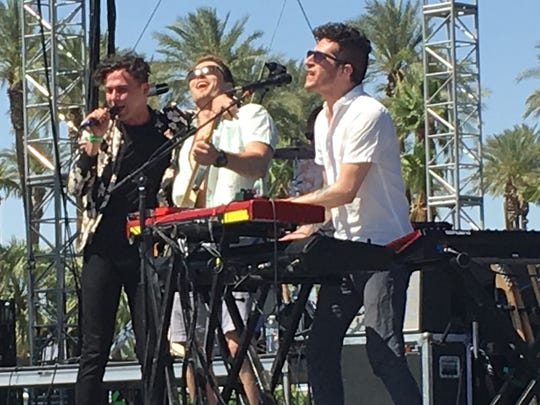 Ross Watt smiles to the heavens while Arkells frontman Max Kerman puts his arm around Ross' shoulder Saturday at Coachella. Ross was plucked from the crowd to play guitar.