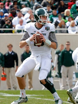 Michigan State quarterback Connor Cook looks to pass during an NCAA college football spring game scrimmage, Saturday, April 25, 2015, in East Lansing, Mich.