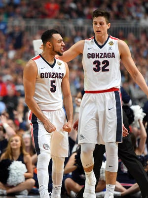 Gonzaga Bulldogs guard Nigel Williams-Goss (5) reacts with forward Zach Collins (32) during the second half during the second half against the South Carolina Gamecocks in the semifinals of the 2017 NCAA Men's Final Four at University of Phoenix Stadium.