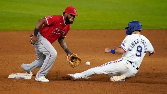 Los Angeles Angels second baseman Luis Rengifo, left, reaches for the throw as Texas Rangers' Isiah Kiner-Falefa steals second during the sixth inning of a baseball game in Arlington, Texas, Wednesday, Sept. 9, 2020. (AP Photo/Tony Gutierrez)