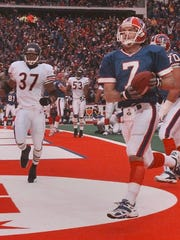 Buffalo QB Doug Flutie scores a 1-yard TD against the