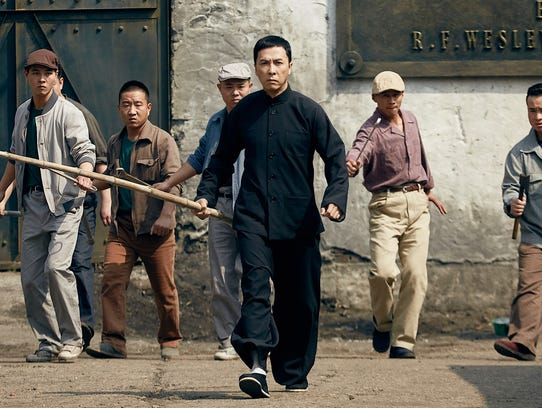 Master Ip (Donnie Yen) prepares to take on a gang of