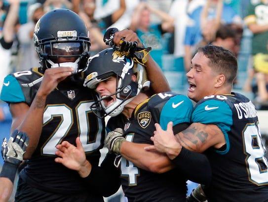 Jacksonville Jaguars kicker Josh Lambo, center, celebrates