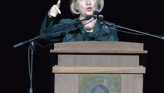 Former Secretary of State Hillary Clinton addresses a group of supporters during a rally for Kentucky democratic senatorial candidate Alison Lundergan Grimes in Highland Heights, Ky., Saturday, Nov. 1, 2014. (AP Photo/Timothy D. Easley)