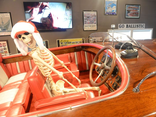 "A skeleton takes the driver's seat of ""Go Ballistic,"" a custom built speedboat on display at Woody's Boathouse."