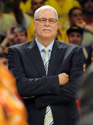 Phil Jackson will be looking on from afar more often as the leader of the Knicks' front office.