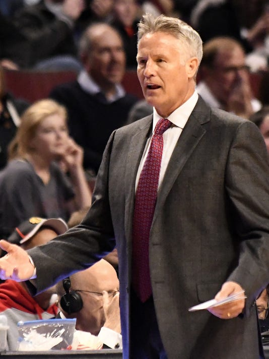 Philadelphia 76ers head coach Brett Brown questions a call during the first half of an NBA basketball game in Chicago, Friday, March 24, 2017. (AP Photo/David Banks)