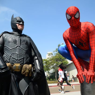 Nerds have descended upon San Diego for Comic-Con International, the annual gathering of entertainment enthusiasts. Dorian Black (left) dresses as Batman and Kyle Blankenfield is Spider-Man.