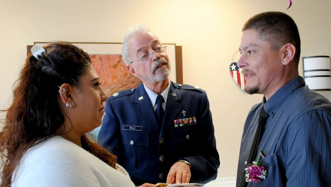 Angelica Begay and her new husband James McDonald are married by retired U.S. Air Force Lt. Col. Chaplain Larry Wills at the Raymond G. Murphy VA Medical Center in Albuquerque.