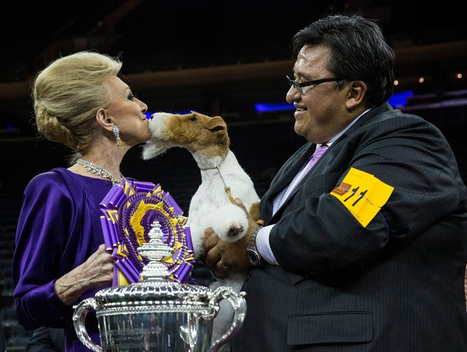 Best in Show winner Sky, a wire fox terrier, thanks judge Betty Regina Leininger with her handler, Gabriel Rangel.