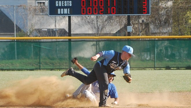 Tommy Gibson of Williamstown looks for the umpire's call after being forced out at second base by Highland's Billy Jackson in Tuesday's Tri-County game.