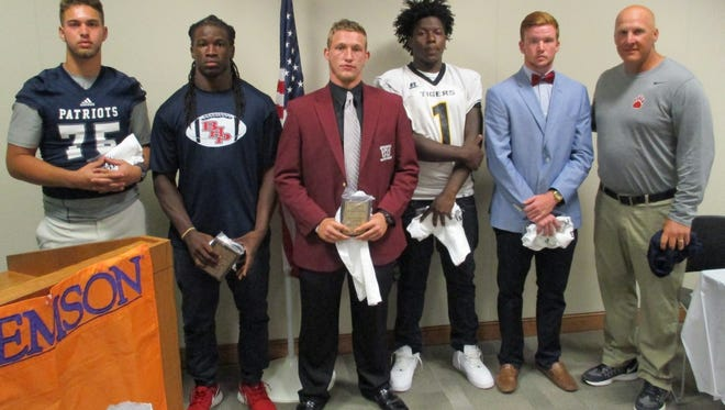 Football players shown from left are Ethan Williams, Eddie Smith, Ronny Walls, D.D. Hull, Alex Meredith; and Coach Russell Blackston.