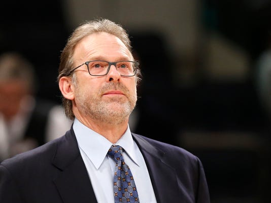 New York Knicks interim head coach Kurt Rambis, coaching his first game in place of Derek Fisher, who's was fired Monday, stands watches from the bench in the first half of an NBA basketball game between the New York Knicks and the Washington Wizards at Madison Square Garden in New York, Tuesday, Feb. 9, 2016. (AP Photo/Kathy Willens)