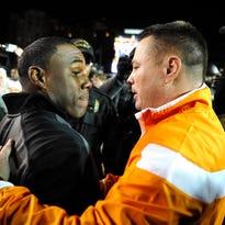 Vanderbilt coach Derek Mason, left, and Tennessee coach Butch Jones meet at midfield after the Vols won 24-17 at Vanderbilt Stadium on Nov. 29, 2014.