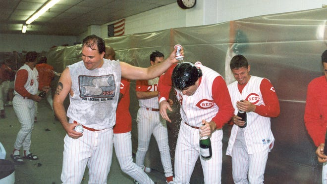 David Wells, Hal Morris and other Reds players celebrate the team's three-game sweep of the Dodgers in their 1995 NL Division Series matchup.