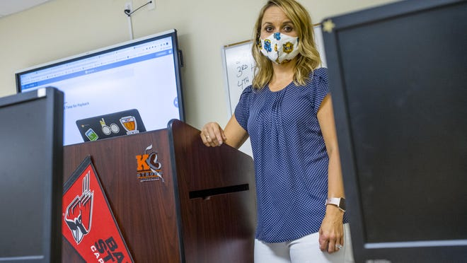 Washington Community High School teacher Sara Ege stands in her classroom Tuesday, Sept. 1, 2020, where she employs a variety of methods to teach business, marketing and technology classes to students home in quarantine.