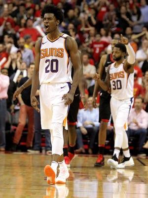Mar 30, 2018; Houston, TX, USA; Phoenix Suns forward Josh Jackson (20) celebrates a go-ahead shot against the Houston Rockets during the fourth quarter at Toyota Center. Mandatory Credit: Erik Williams-USA TODAY Sports