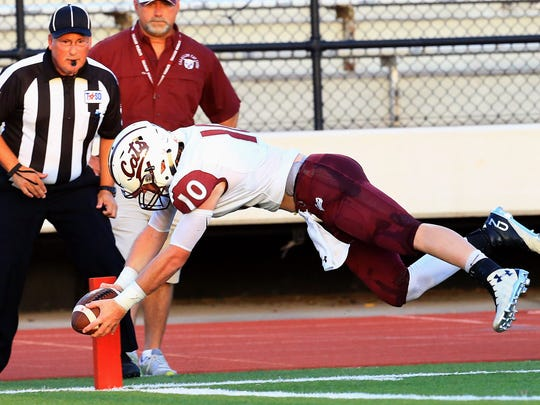 GABE HERNANDEZ/CALLER-TIMESCalallen's Colton Duff reaches to score a touchdown against King on Thursday, Sept. 8, 2016, at Buccaneer Stadium in Corpus Christi.