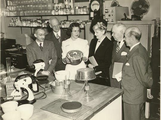 In this undated photo, Marjorie Merriweather Post, fourth from left, tours a kitchen.